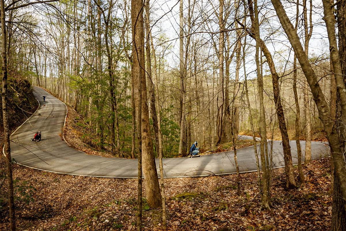This corner is extremely strange. It's steep on the entrance, then flattens out and goes uphill and super off-camber at the exit. Madison Crum leading, then Dexter Manning and Garrett Gourley.