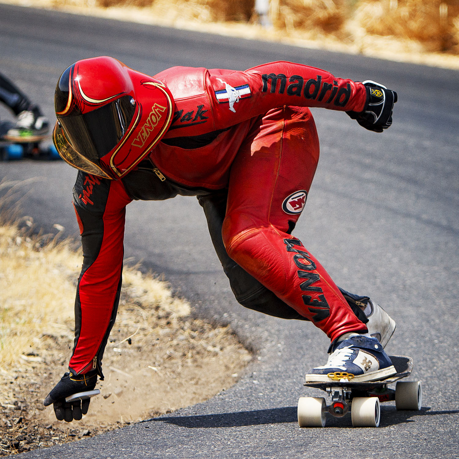 Zak Maytum racing at Maryhill in his Tanner Leaser painted original Fasttrack helmet, 2012.
