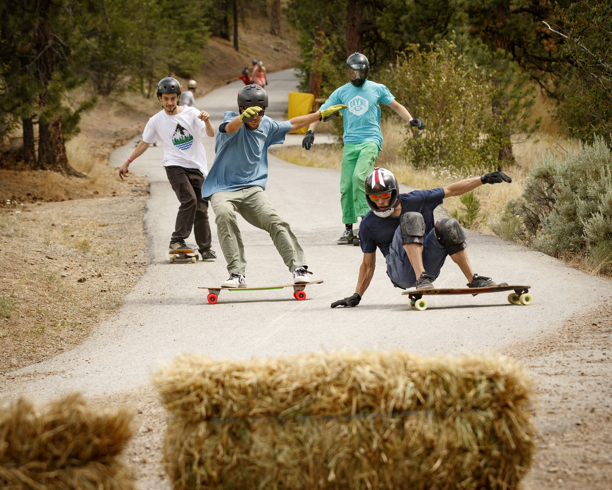 This scene is typical Giants Head: four skaters riding wildly different setups in completely different styles are all shutting down for the notorious Gravel Corner by the top of the hill.
