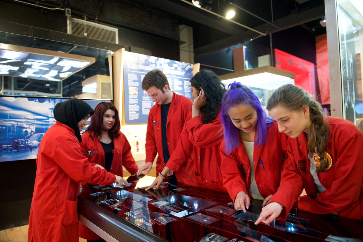 The Science School's student Science Communicators in their distinctive red lab coats. Photo courtesy of the Ontario Science Centre .