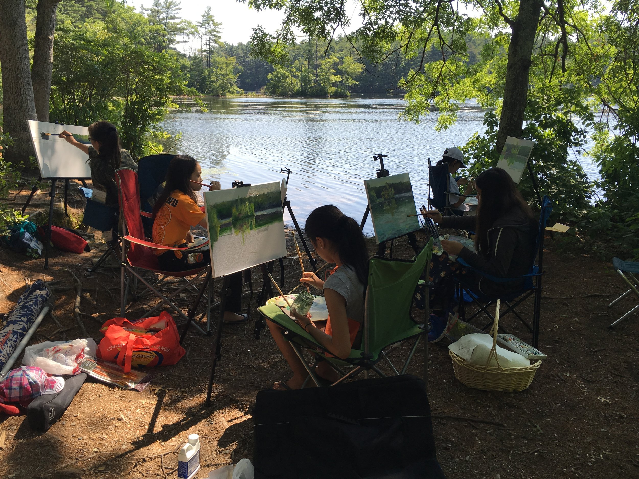 Students painting at Field Pond