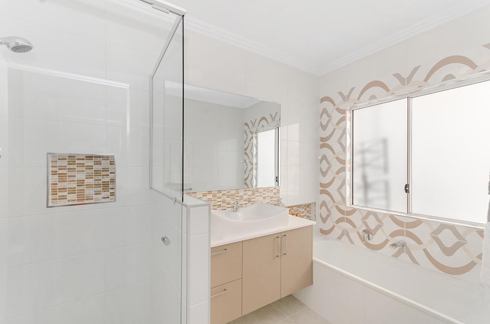 Harris Crossing Display Home   Floor - Marmo Crema Gloss 500x500  Walls - Gloss White 300x600  Niches/Vanity Splash back - Bluetooth Travertino Noce 15x50