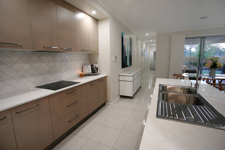 North Shore Display Home   Floor - Metropolis White Gloss 450x450  Splash back - Gloss White 100x200 in Herringbone Pattern