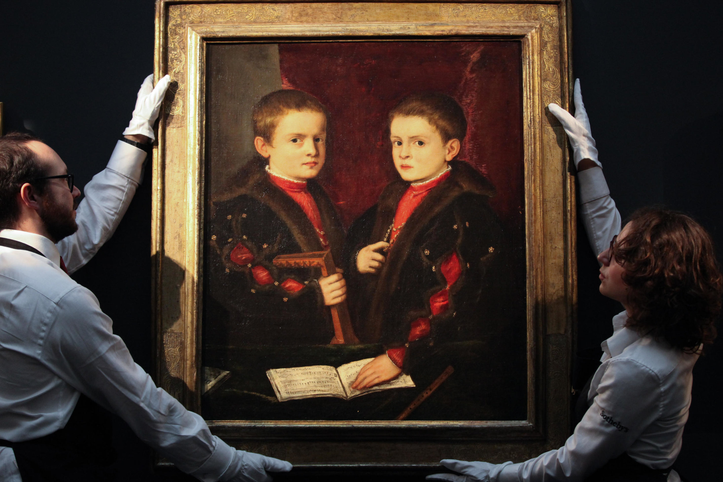 A member of staff views A Mesmerising Portrait of Two Boys, said to be Members of the Pesaro Family est, £1- £1.5 million, by Titian 1485_90-1576 .jpg