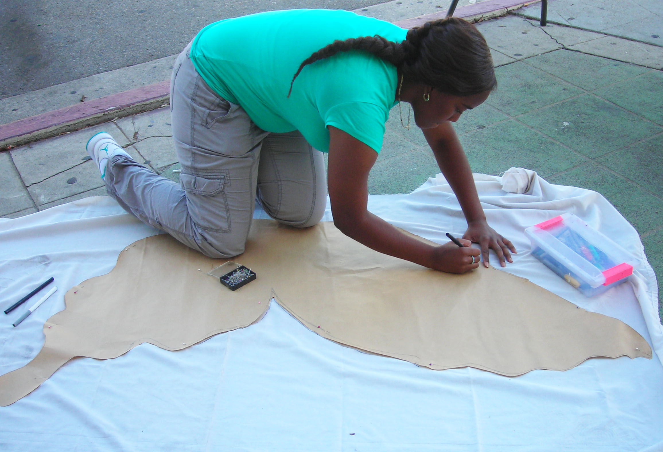 Drawing wings on Leimert sidewalk.jpg