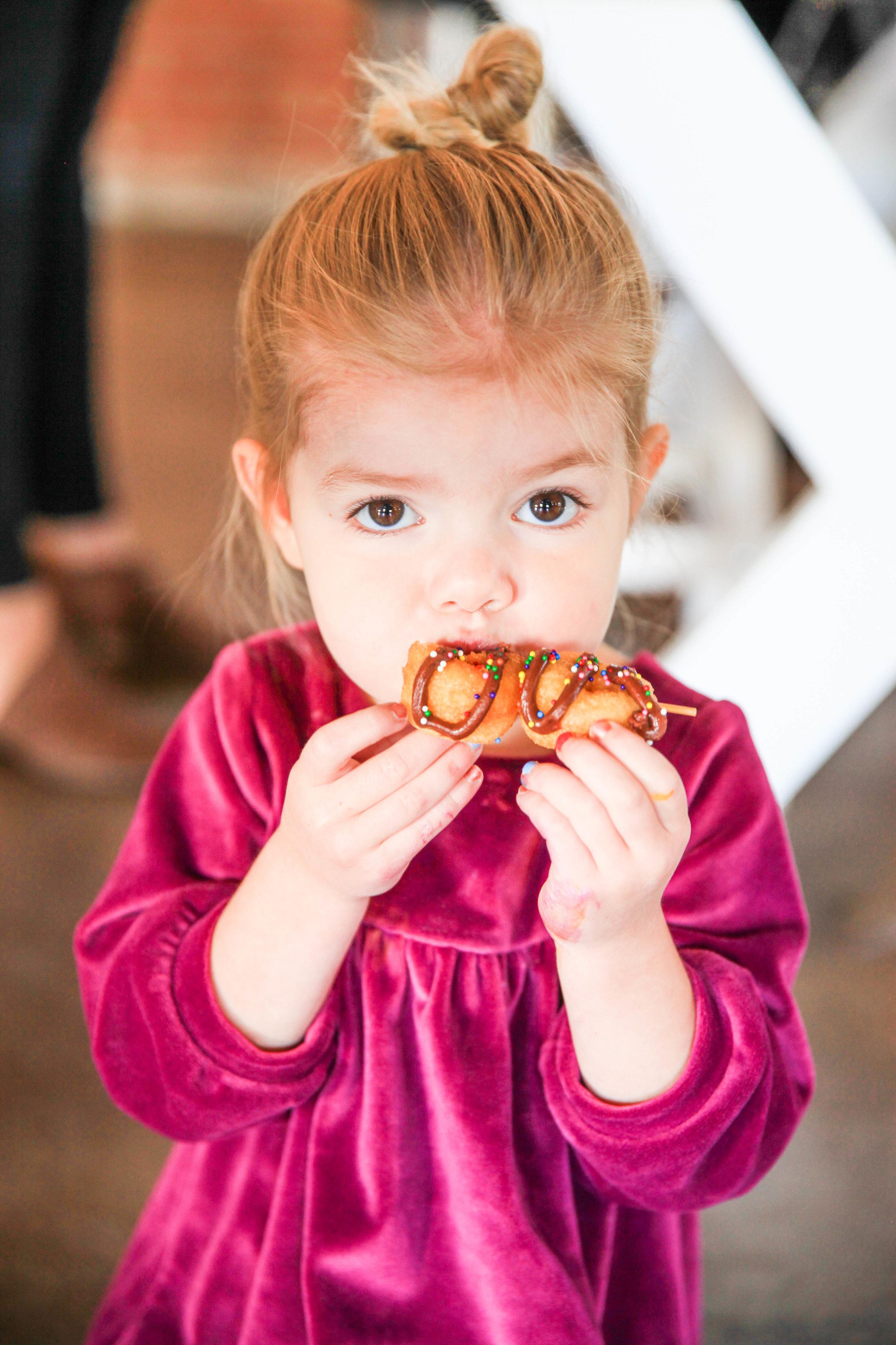 Child Eating Donut 2.jpg