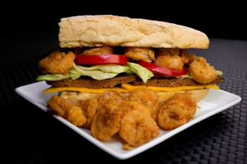 (Pictured) N'Awlins Po Boy Sandwich (Beef Hot Sausage & Shrimp) ($18.00) Additional .75 for cheese