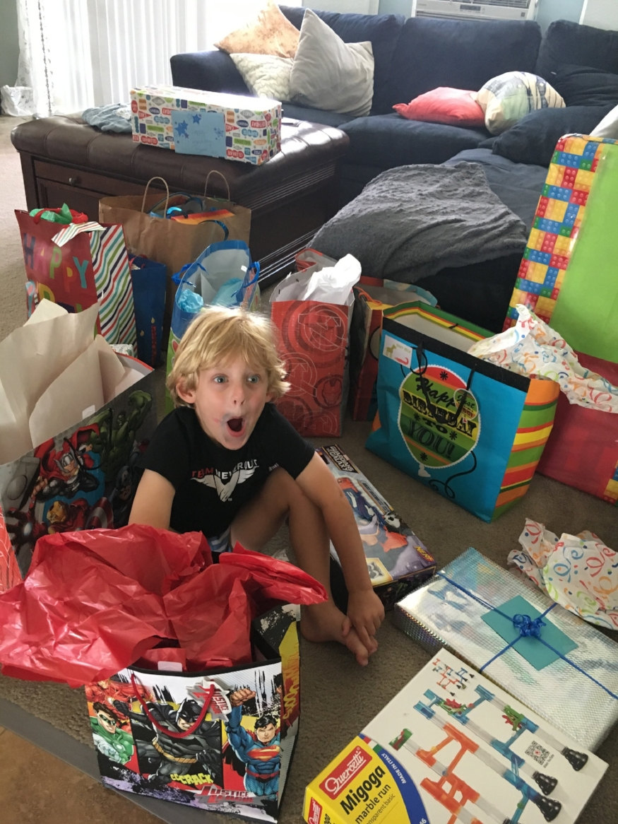 the face a kid makes when he realizes he has more birthday gifts than he can count. #spoiledrotten #freakingout #beyondexcited #happybirthdayBravery #nomorepresentsuntilChristmas #broke #worthit #yolo