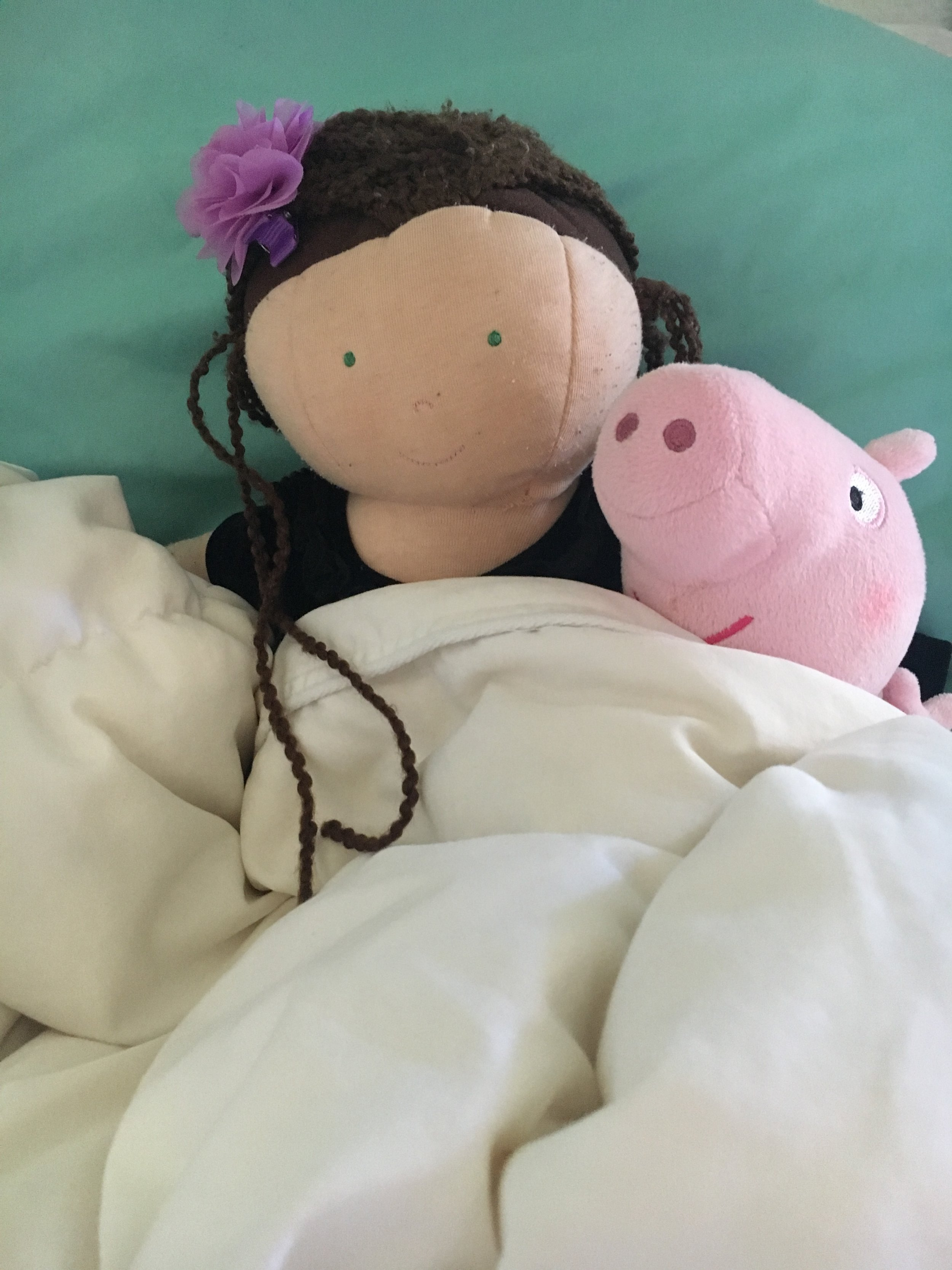 Amelie and Peppa, snuggling.