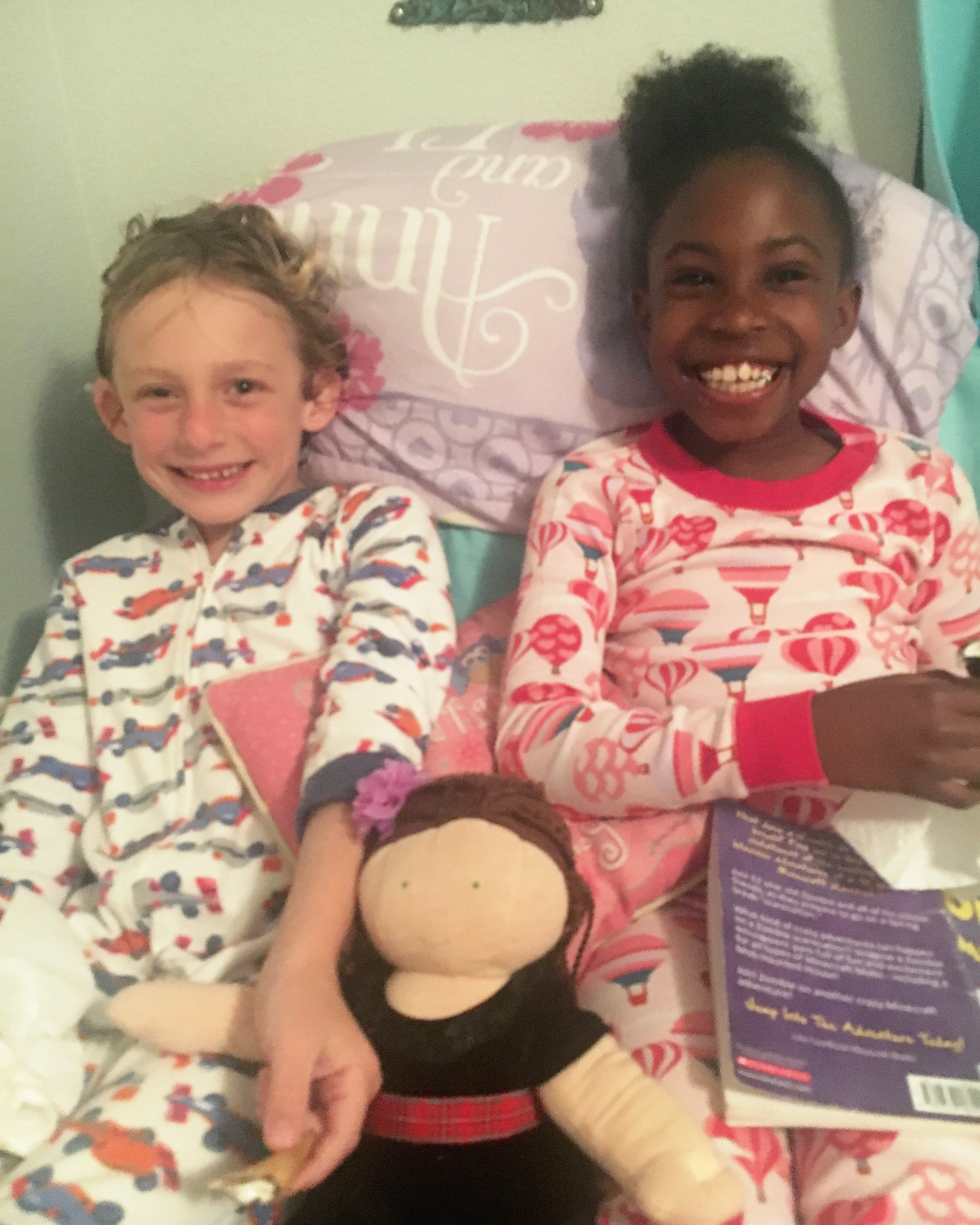 Bravery, Amelie Doll, and Ayzia on Amelie's bed for night time reading and cookies. Ayzia in Amelie's pajamas.