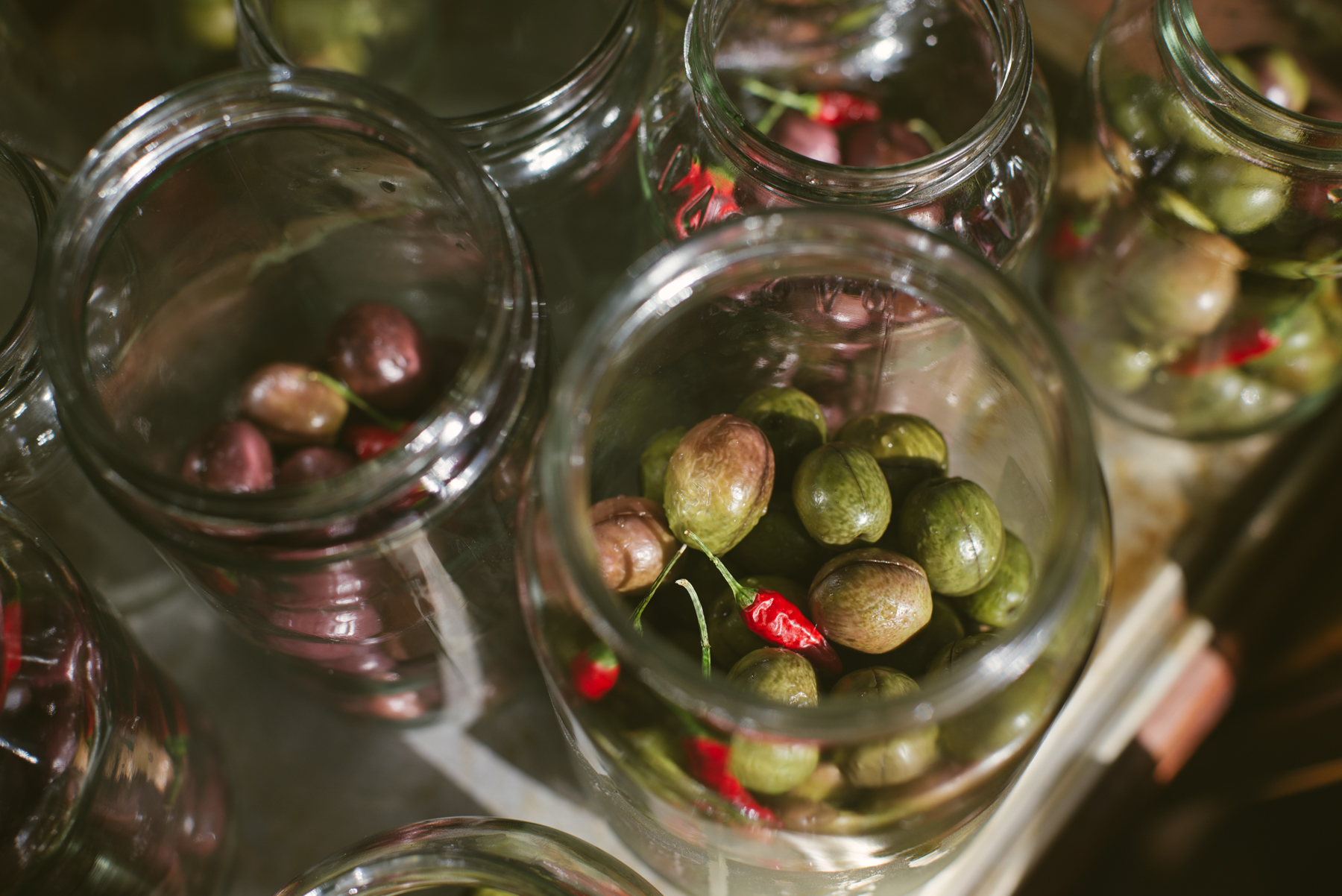 We filled half the jars, then added chillies, oregano and garlic (which Eunice kindly ran out to IGA to get).