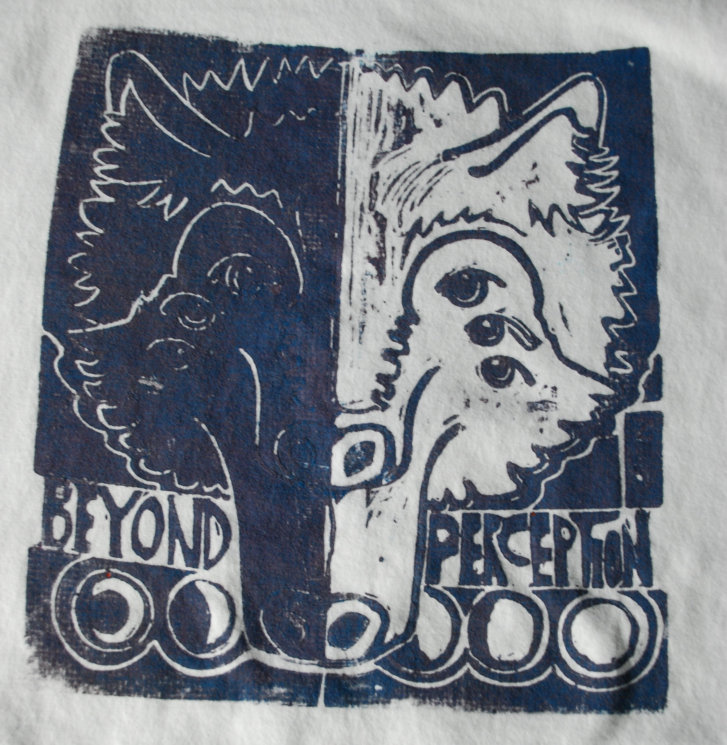 "Hand carved and hand stamped! The original SAVAGE WOLF ""Beyond Perception"" T-Shirts for all Ages!"