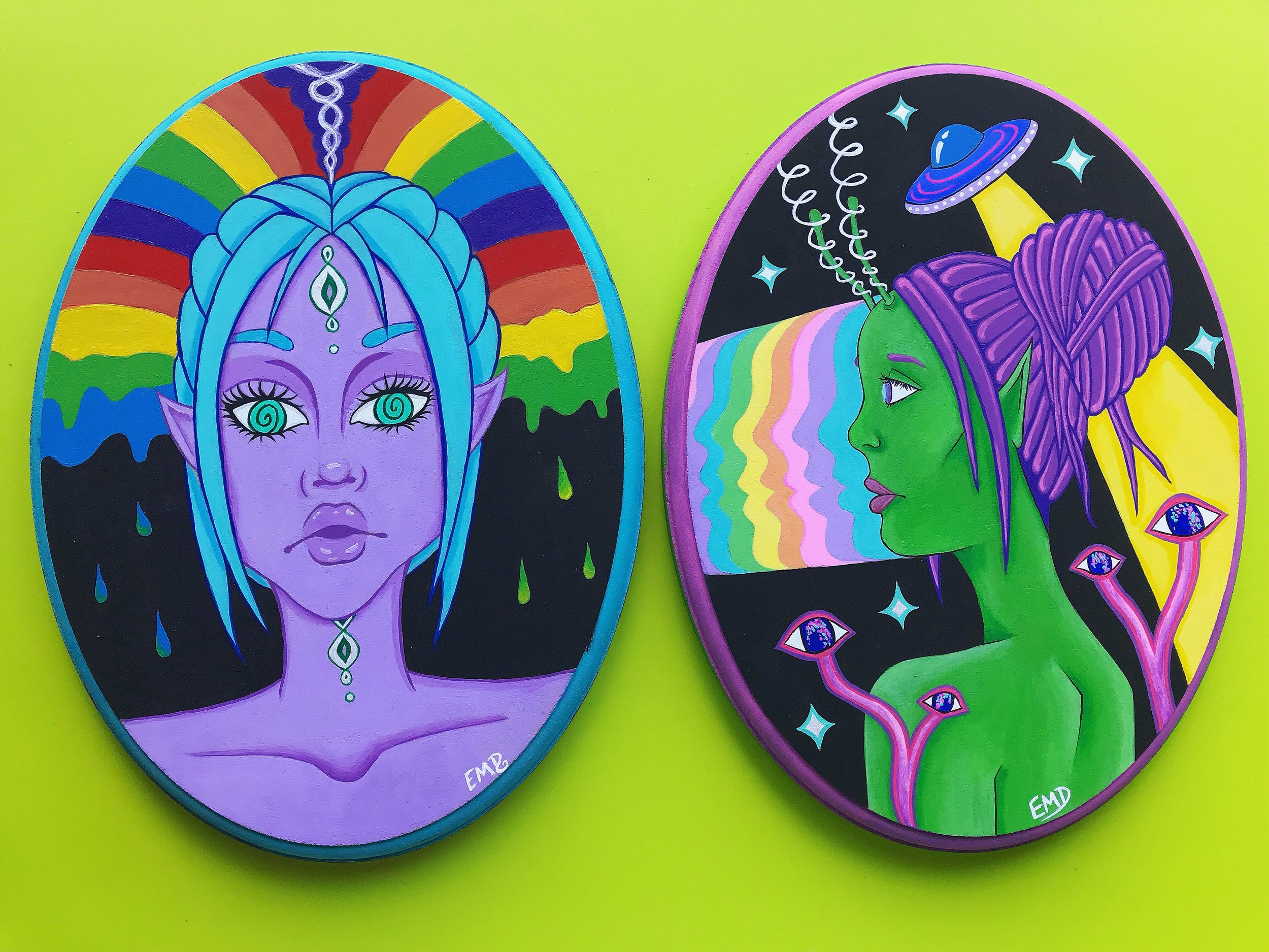 Galaxy sisters both painted on repurposed wood blocks from goodwill.