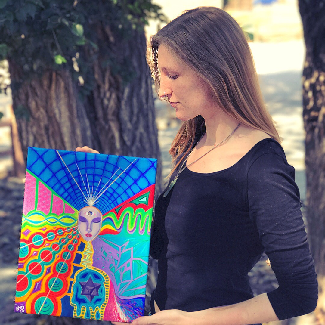 """Me holding my """"development"""" painting, acrylic on canvas."""