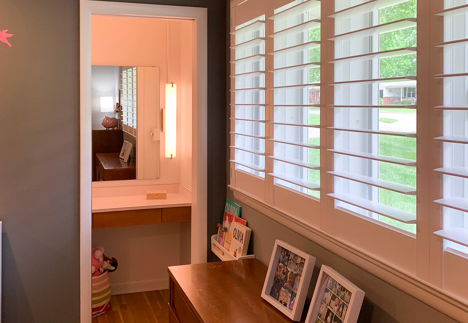 Feature Highlight - In addition to two closets, the first bedroom has a one-of-a-kind vanity room with a pocket door plus the original vanity desk and counter. The room was designed for the original homeowners' daughter.
