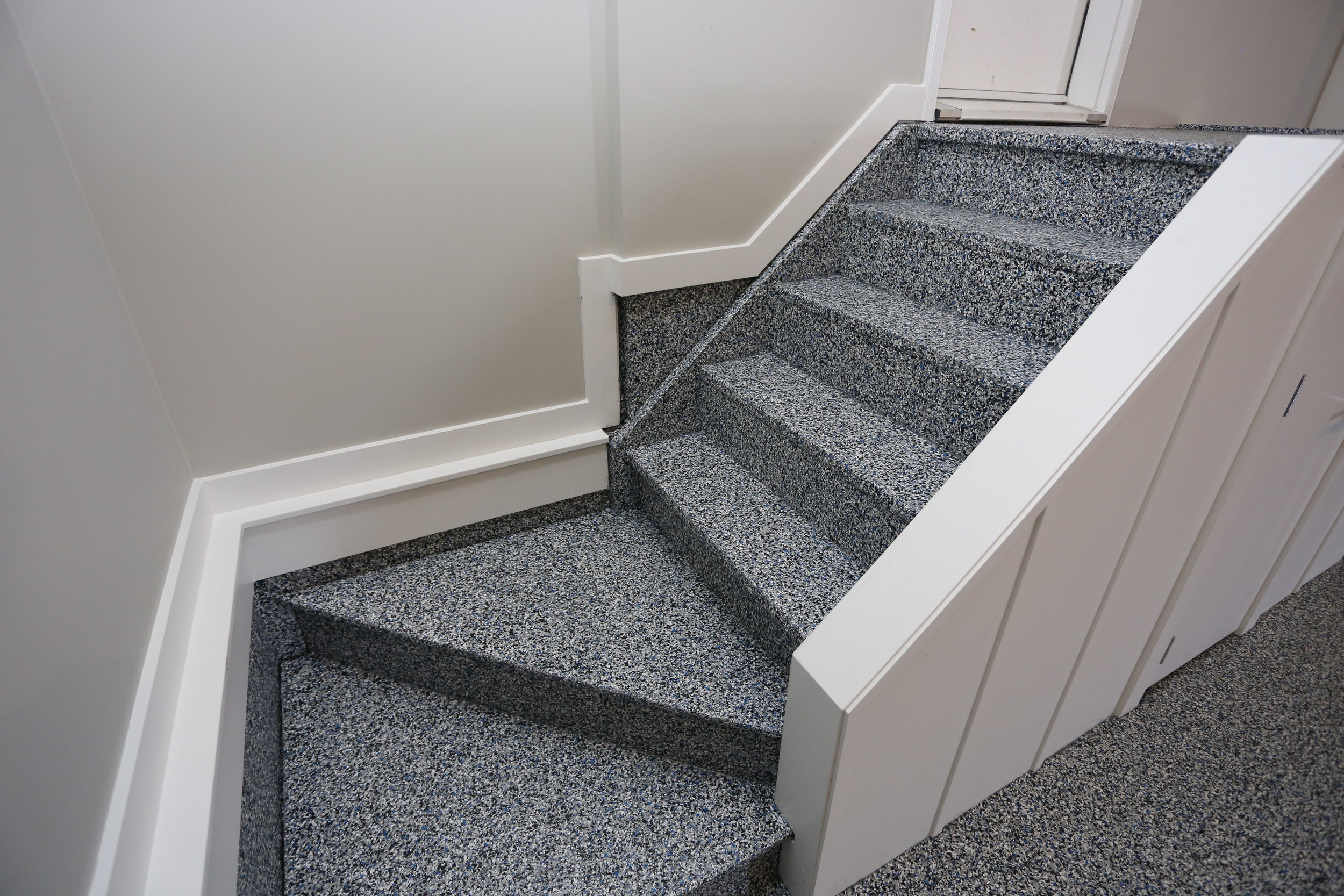 Garage Stairs Coating - We can coat wood stairs with our Polyaspartic Coating to match the Garage Floor.