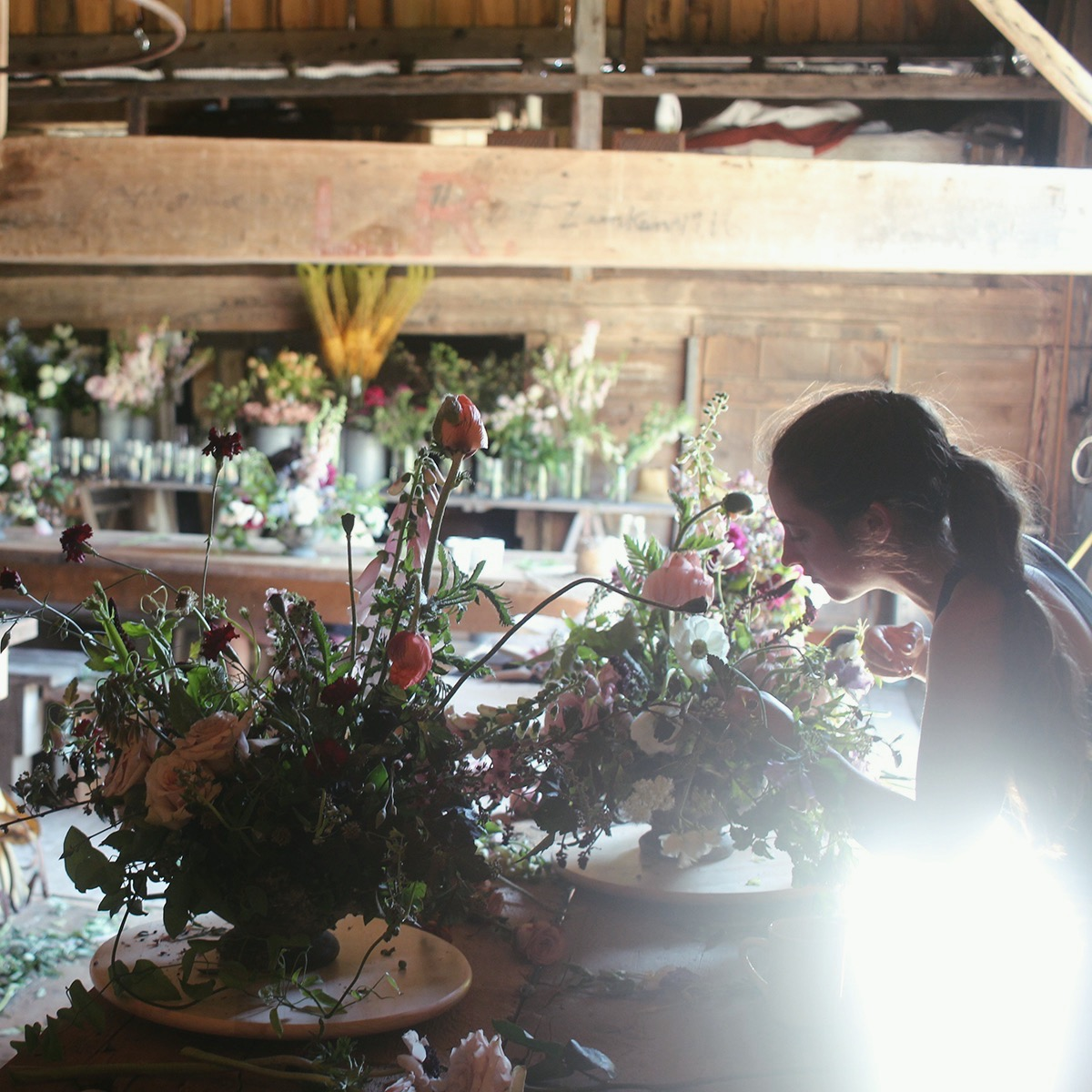 designing centerpieces in barn.jpg