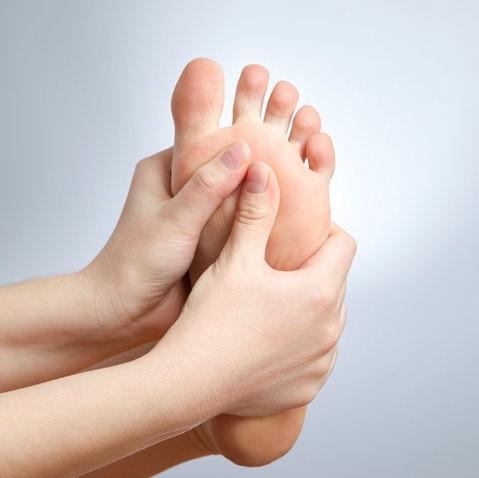 hands massaging foot