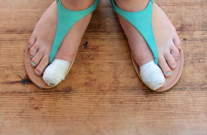 feet with two bandaged big toes