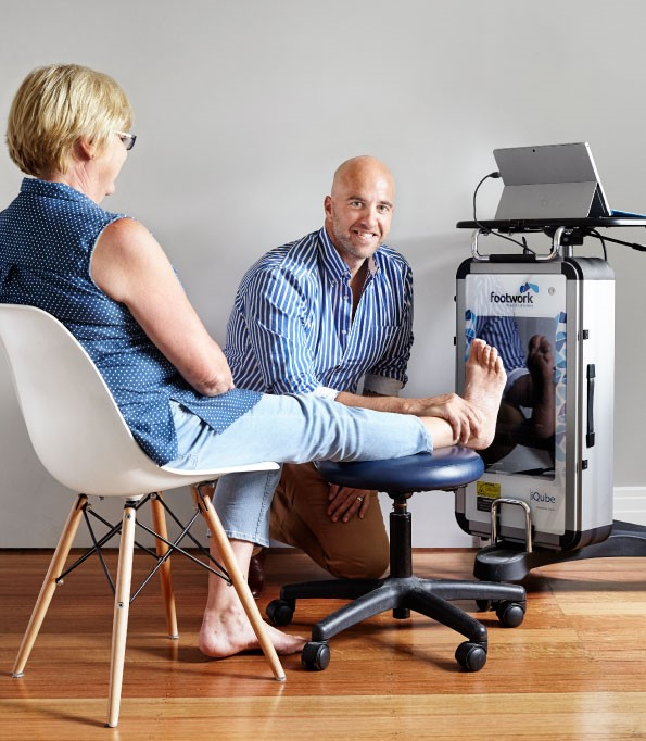 doctor foot scanning a patient for orthotics