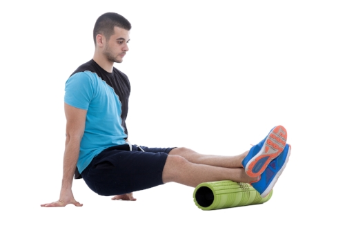 Man foam rolling calves.jpg