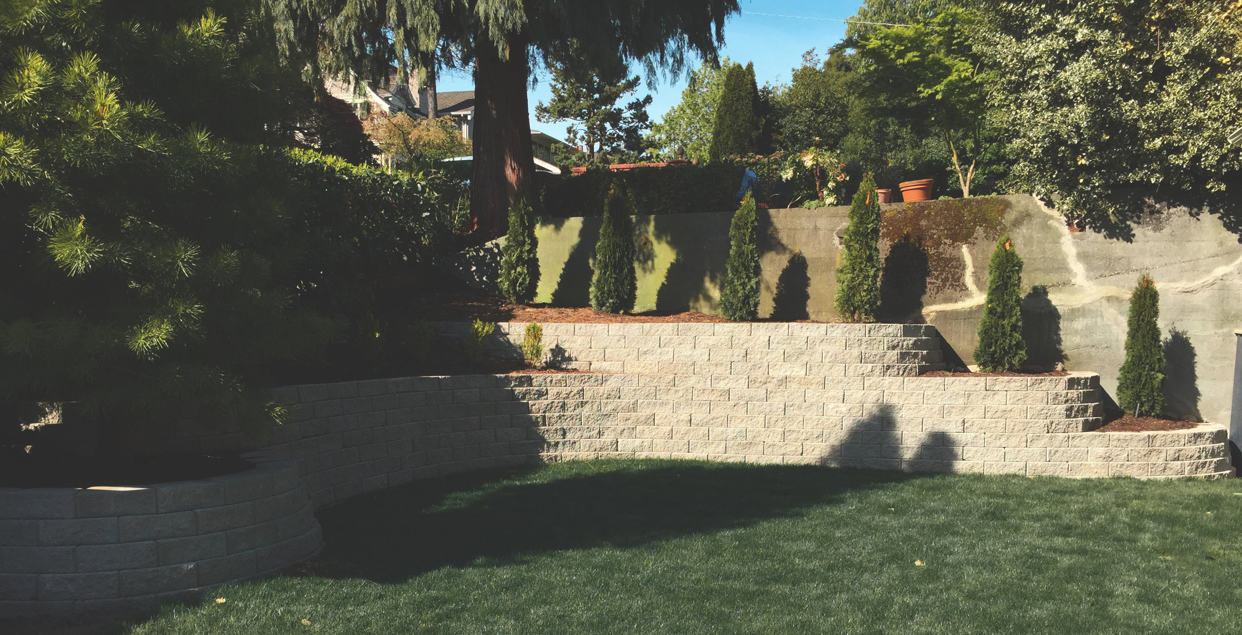 Curving terraced walls  (Built with Eastside-Anchor straight faced wall block)