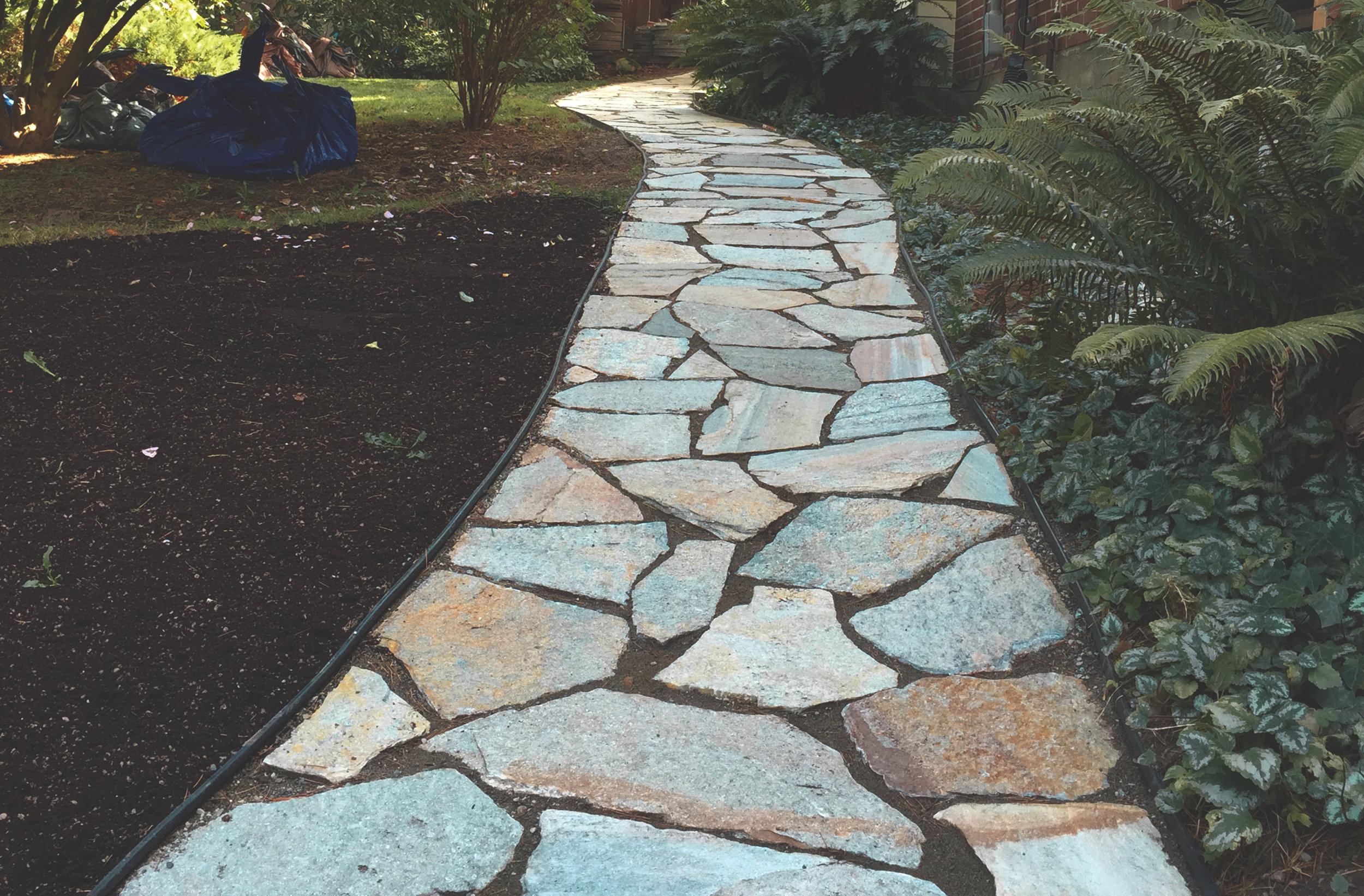 Natural stone walkway  (Built with Cowboy Coffee Flagstone)
