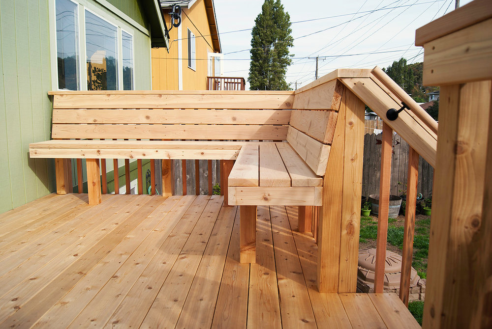 "Craftsmen style deck with built-in wrap around bench  (Deck composed of 6"" decking. Built with all tight knot cedar lumber.)"