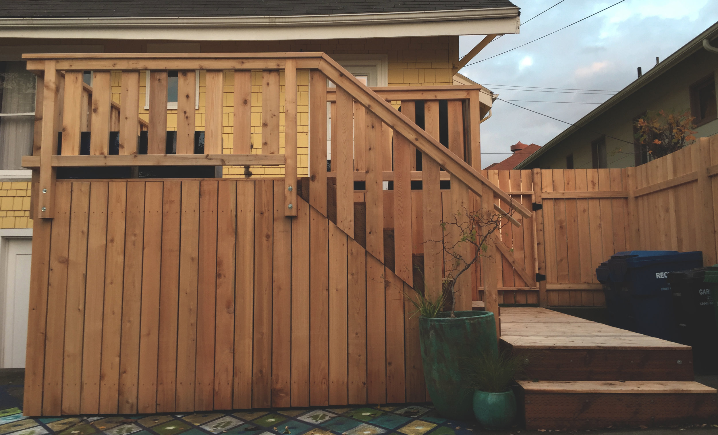 "Modern meets craftsmen deck  (Deck composed of 6"" decking, and enclosed lower section constructed with 6"" fence boards. Built with all tight knot cedar lumber.)"