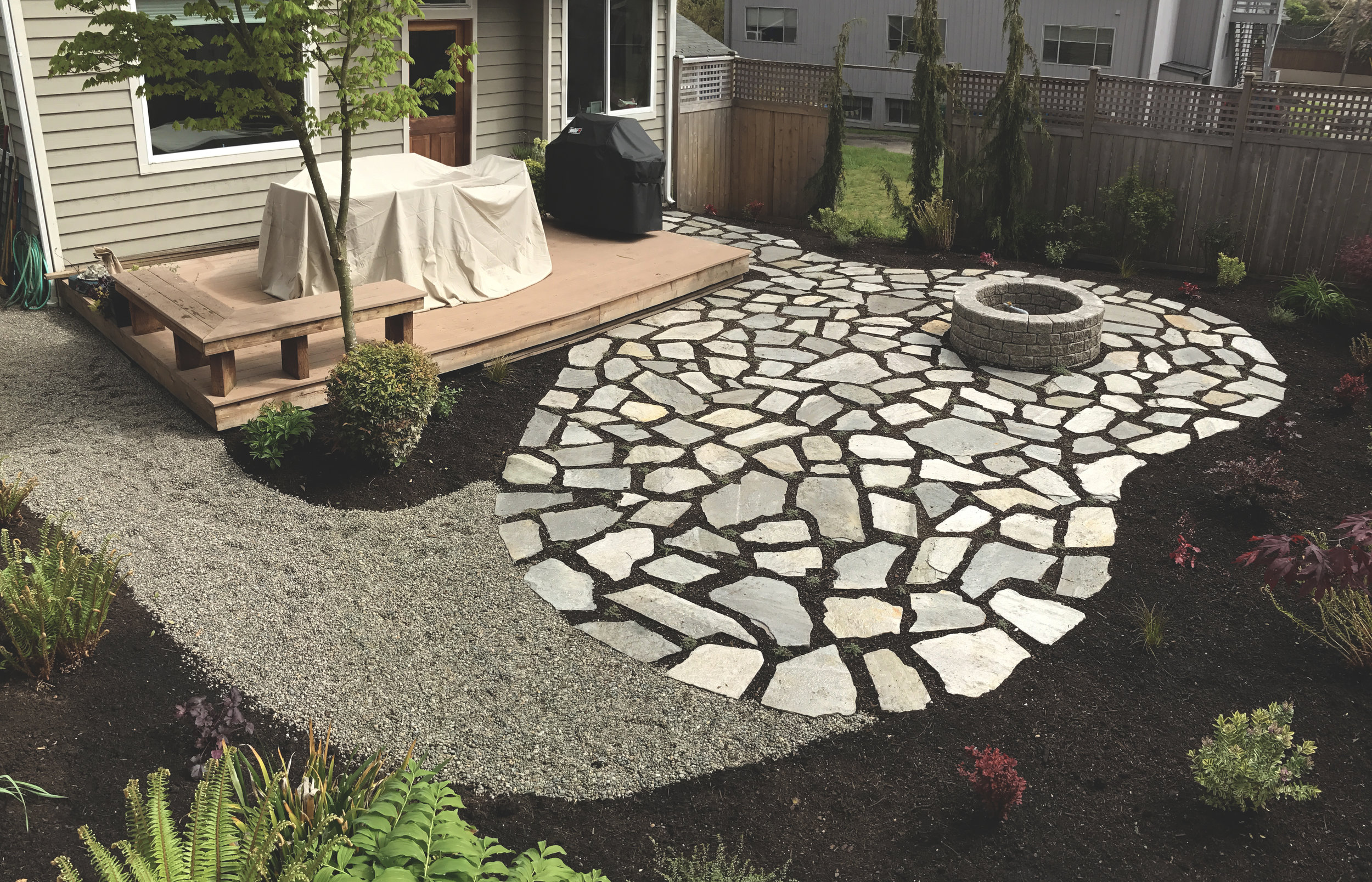 Kidney bean natural stone patio  (Built with Cowboy Coffee flagstone)