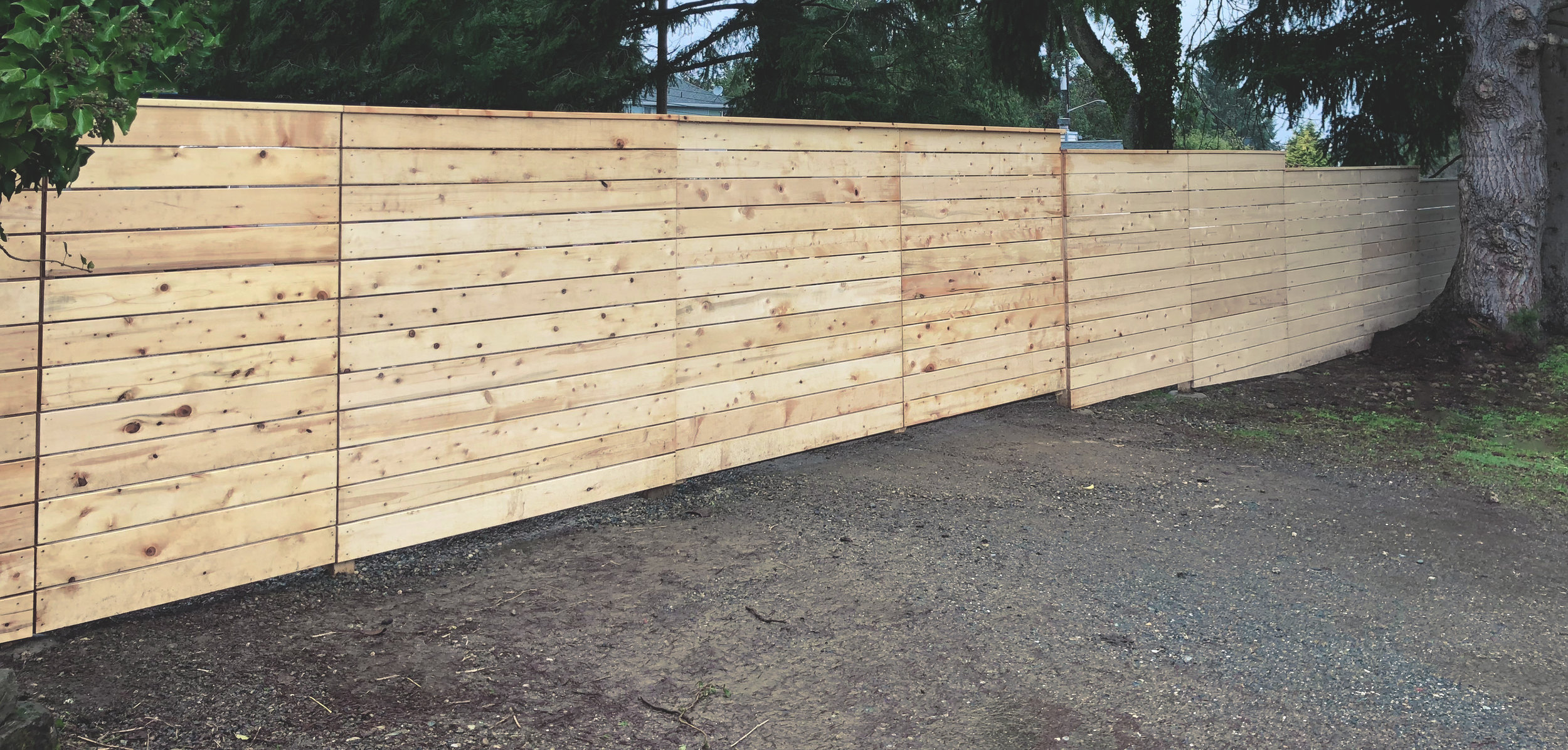 "Modern horizontal fence  (Fence composed of 5/4 x 6"" decking. Built with all tight knot Alaskan Yellow Cedar lumber.)"