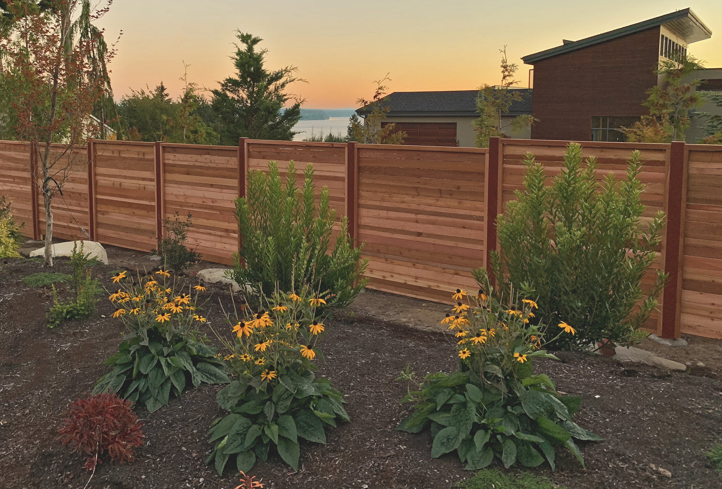 "Custom modern horizontal double offset pattern fence  (Offset pattern composed of alternating double 2"" & 4"" rough cut fence boards. Built with all tight knot cedar lumber.)"