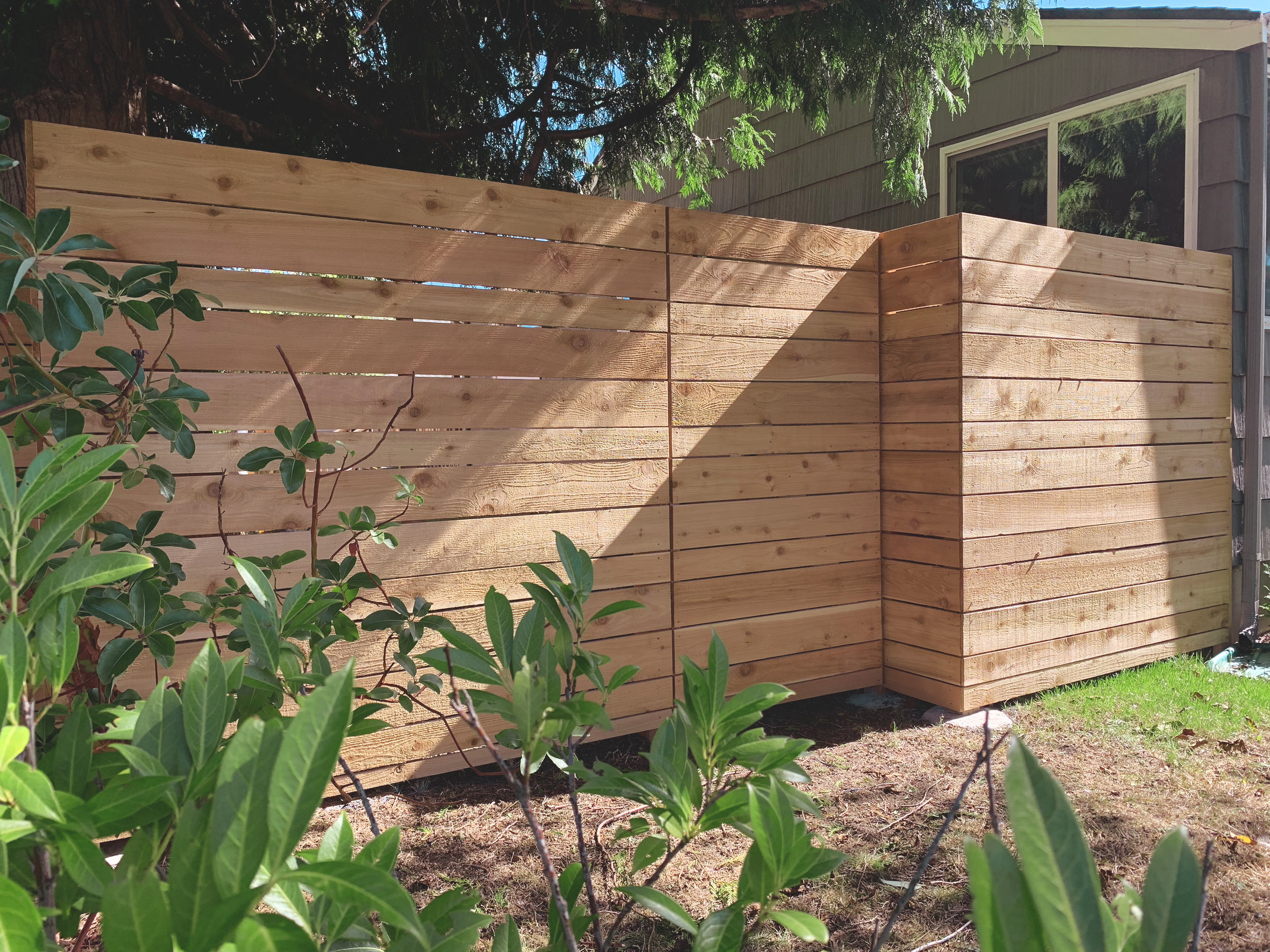 "Basic modern horizontal offset pattern fence  (Offset Pattern composed of alternating 6"" & 4"" rough cut fence boards. Built with all tight knot cedar lumber.)"