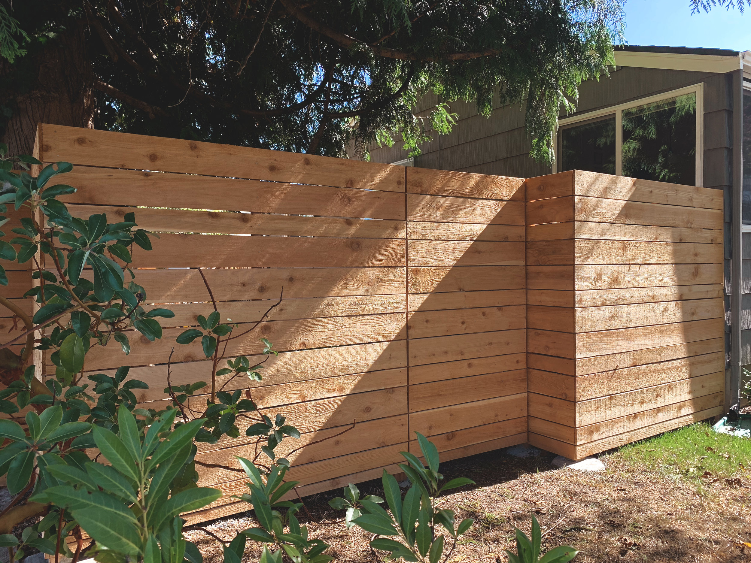 "Modern Horizontal Offset Pattern Fence  (Offset Pattern composed of alternating 6"" & 4"" rough cut fence boards. Built with all tight knot cedar lumber.)"