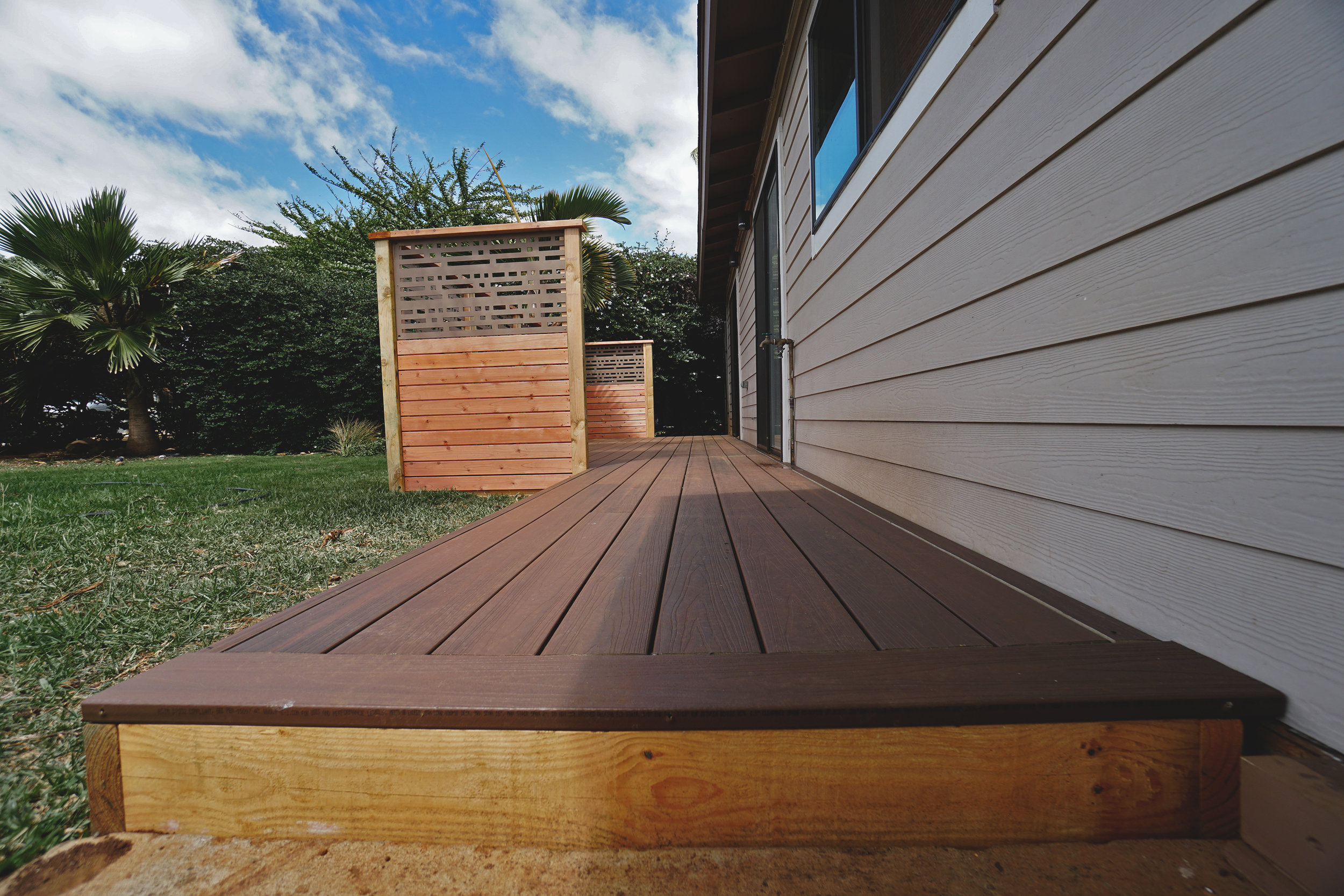 "Composite deck & boardwalk  (Deck composed of 6"" decking. Built with Fiberon decking with hidden fasteners.)"