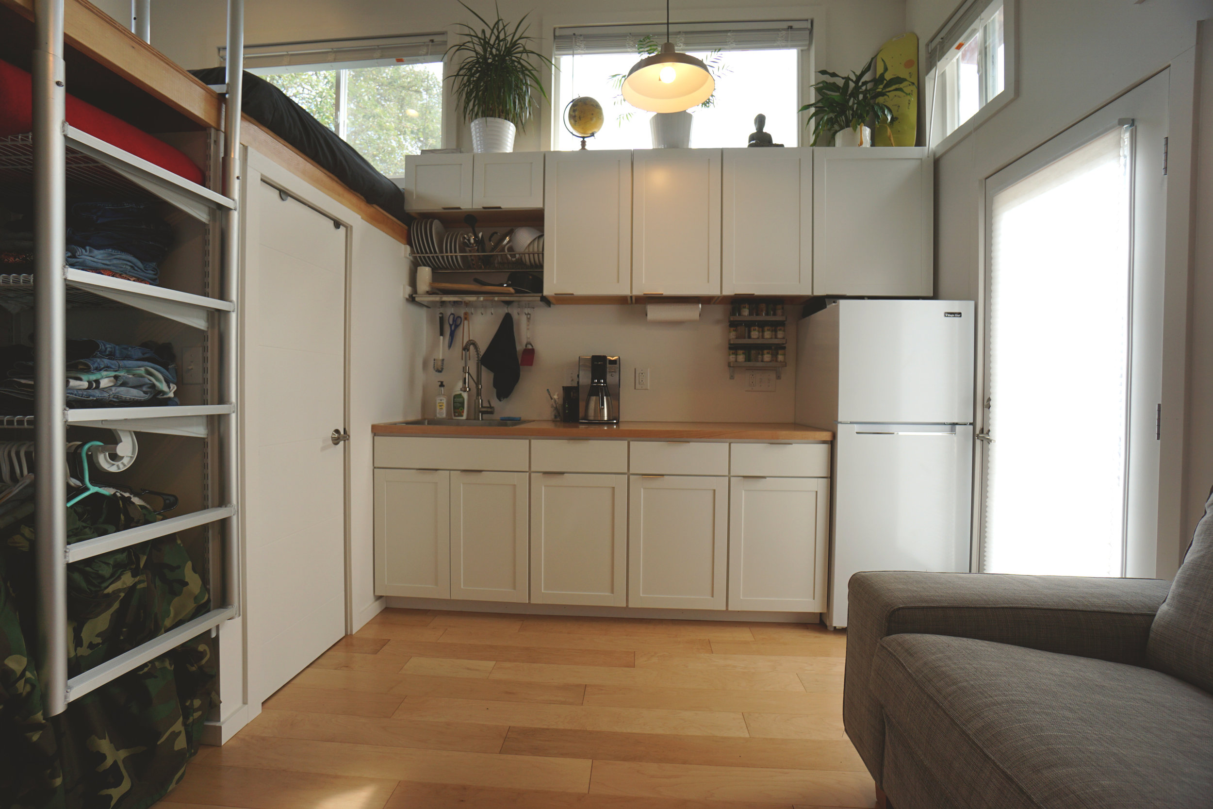 Modern studio kitchen design & install  (Installation of new white shaker cabinets with stainless steel finger pulls, butcher block countertop with deep stainless steel sink and maple floors)