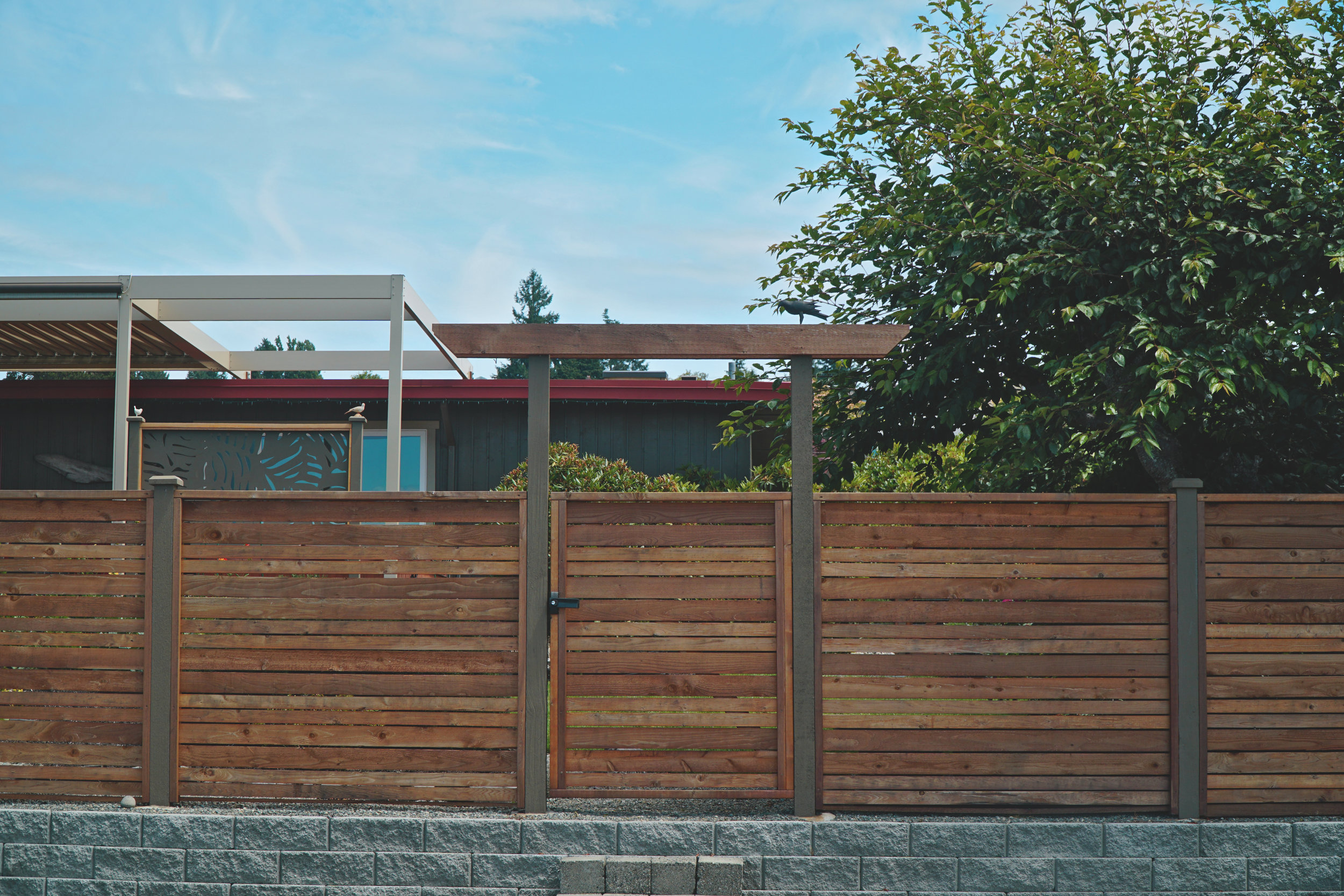 "Custom modern horizontal fence  (Built with rough cut cedar posts and custom milled 2"" & 3"" alternating cedar fence boards)"