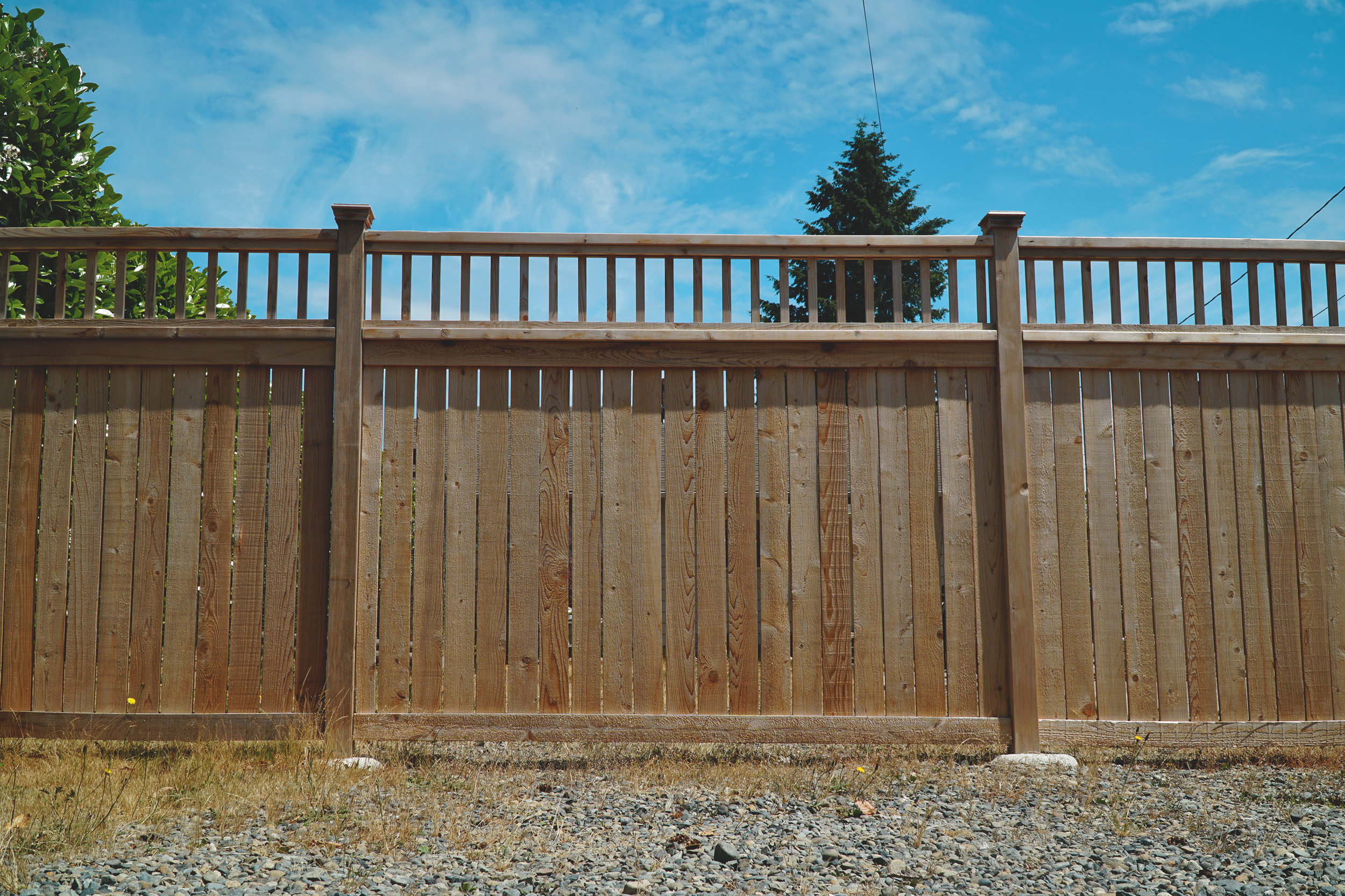 Custom craftsmen fence with baluster window  (Built with all tight knot cedar lumber)