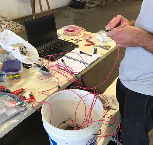 Gurr attaching his custom heartbeat sensors.