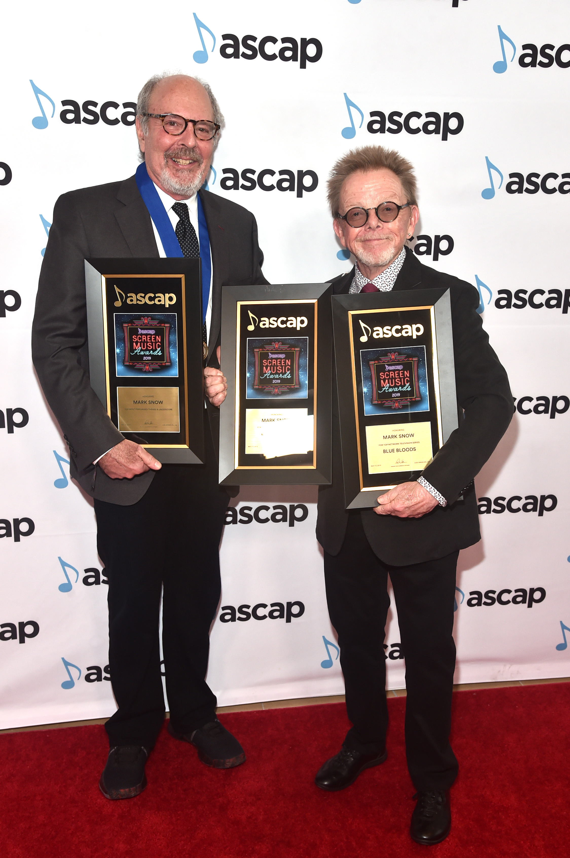 BEVERLY HILLS, CALIFORNIA - MAY 15: Composer Mark Snow (L) winner of the award for Top Network Television Series 'Blue Bloods' and the award for Most Performed Themes and Underscores and ASCAP President and Chairman of the Board Paul Williams attend the ASCAP 2019 Screen Music Awards at The Beverly Hilton Hotel on May 15, 2019 in Beverly Hills, California. (Photo by Alberto E. Rodriguez/Getty Images for ASCAP)