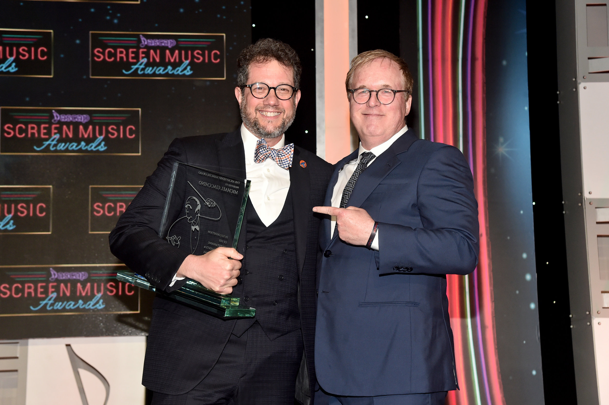 BEVERLY HILLS, CALIFORNIA - MAY 15: (L-R) ASCAP Henry Mancini award winner Michael Giacchino and director Brad Bird stand onstage during the ASCAP 2019 Screen Music Awards Show at The Beverly Hilton Hotel on May 15, 2019 in Beverly Hills, California. (Photo by Alberto E. Rodriguez/Getty Images for ASCAP)