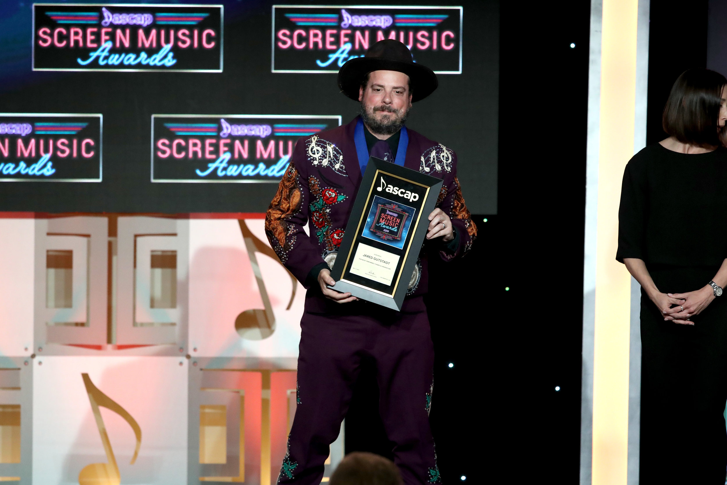 BEVERLY HILLS, CALIFORNIA - MAY 15: Composer Jared Gutstadt, winner of the award for Most Performed Themes and Underscores stands onstage during the ASCAP 2019 Screen Music Awards at The Beverly Hilton Hotel on May 15, 2019 in Beverly Hills, California. (Photo by Ari Perilstein/Getty Images for ASCAP)