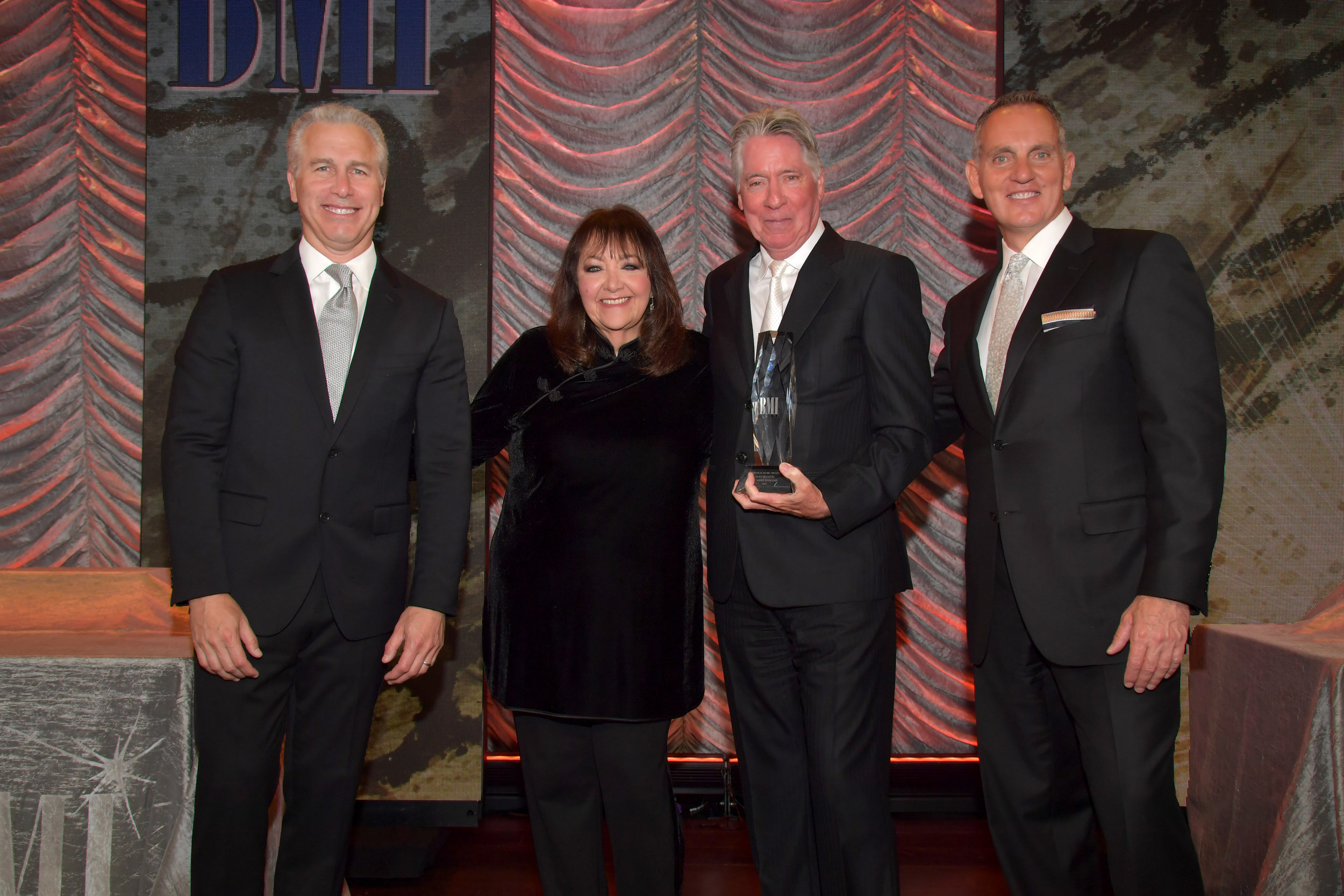 BEVERLY HILLS, CALIFORNIA - MAY 15: BMI Executive Vice President of Creative & Licensing Mike Steinberg, BMI Creative - Film, TV & Visual Media VP Doreen Ringer-Ross, Alan Silvestri and BMI President & Chief Executive Officer Mike O'Neill attend the 35th annual BMI Film, TV & Visual Media Awards on May 15, 2019 in Beverly Hills, California. (Photo by Lester Cohen/Getty Images for BMI)