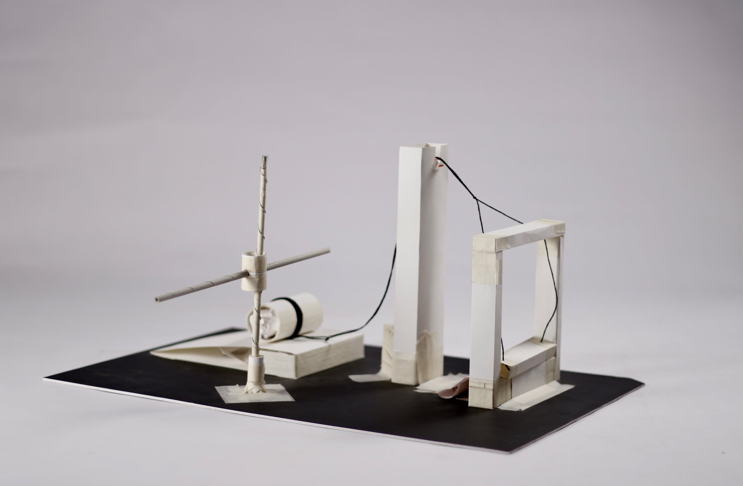 Rube Goldberg Mechanism   A Rube Goldberg machine is a deliberately complex contraption in which a series of devices that perform simple tasks are linked together to produce a domino effect in which activating one device triggers the next device in the sequence.   Medium:  Paper