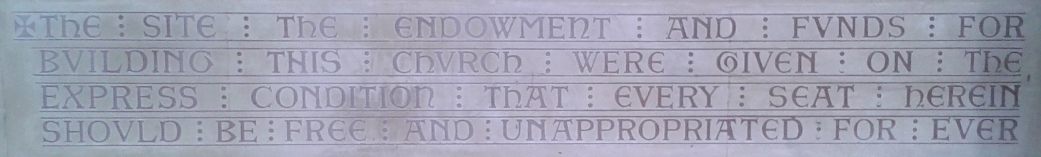 Inscription in the porch at St Peter's.