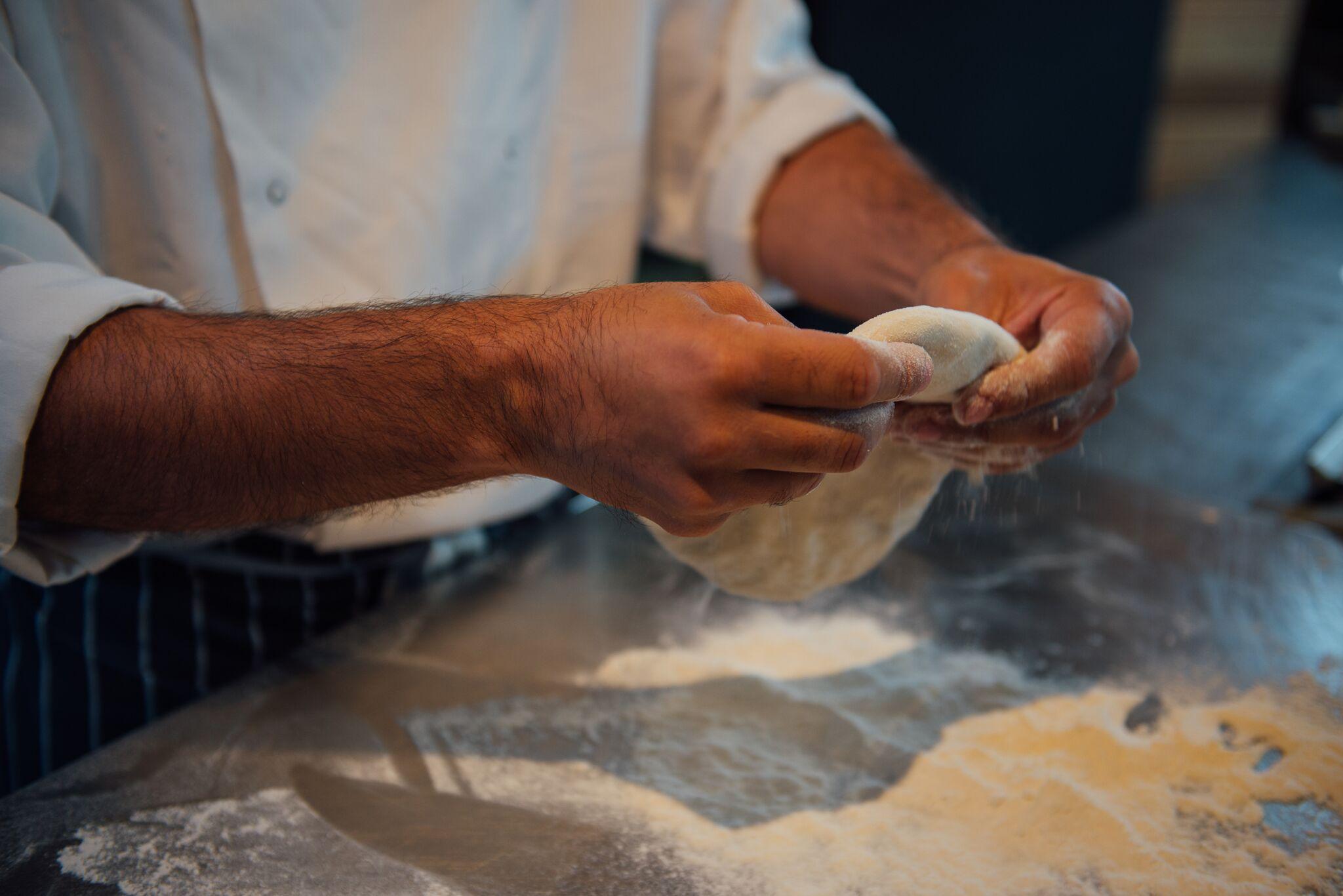 Red Lion Kitchen Chefs Hands w: Dough.jpg
