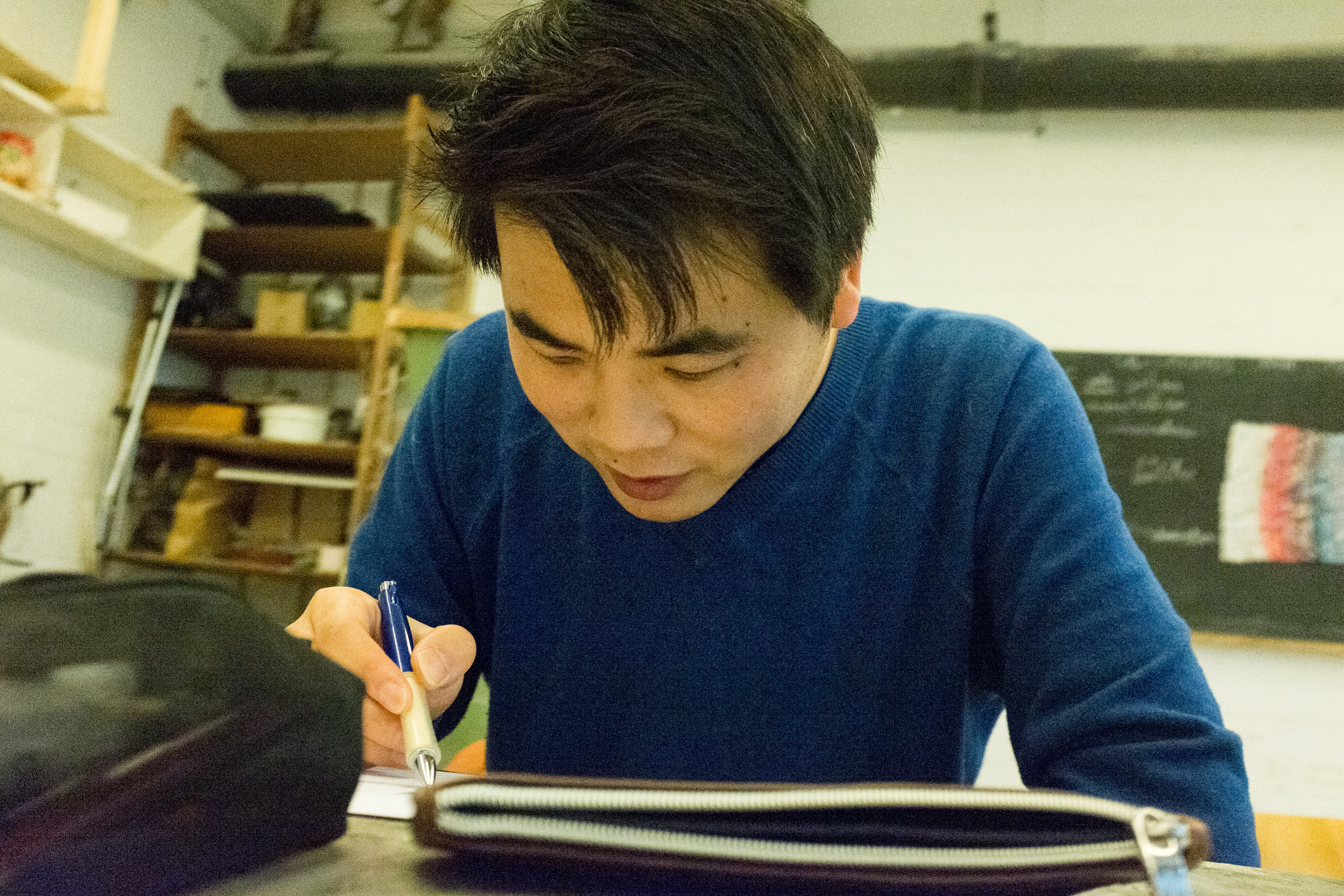 Wei is drawing his sketching