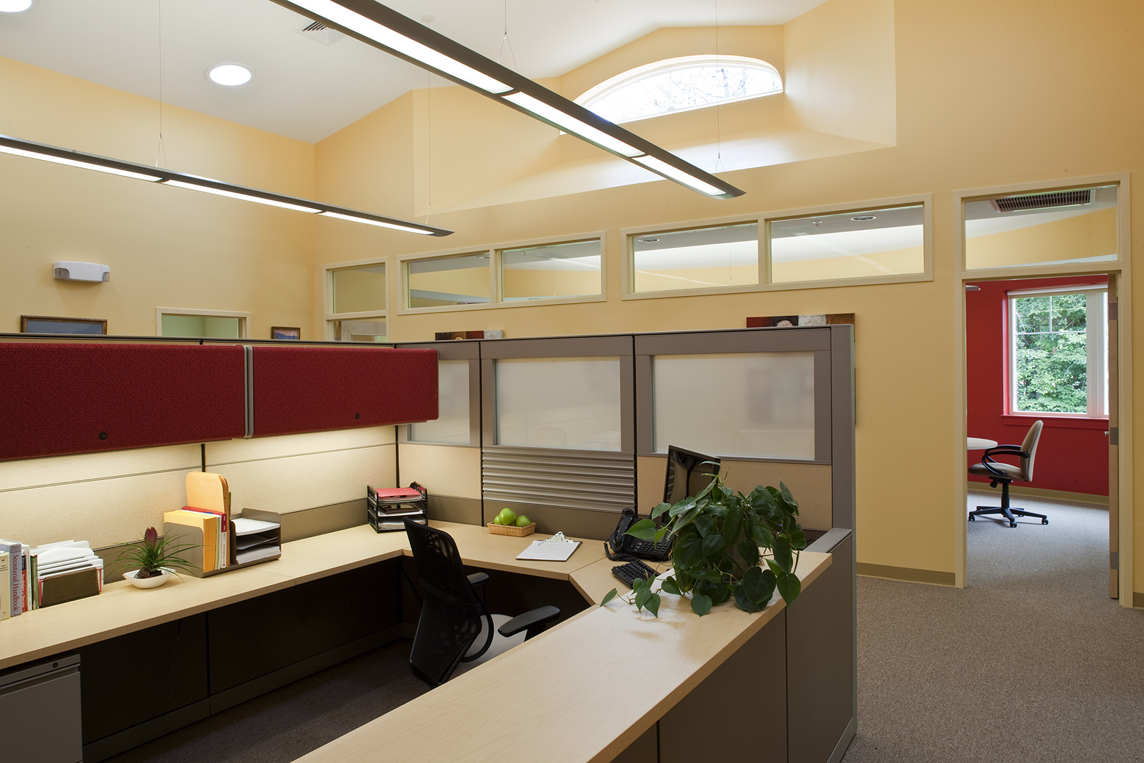 Interior clerestory windows and tubular skylights direct natural light toward interior workspaces.