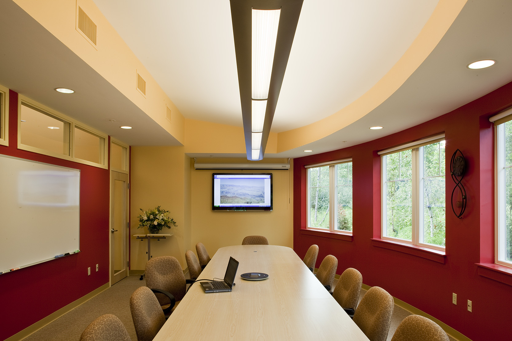 The curved conference room, adjacent to the break room and back patio, is used for presentations to the board and top management.