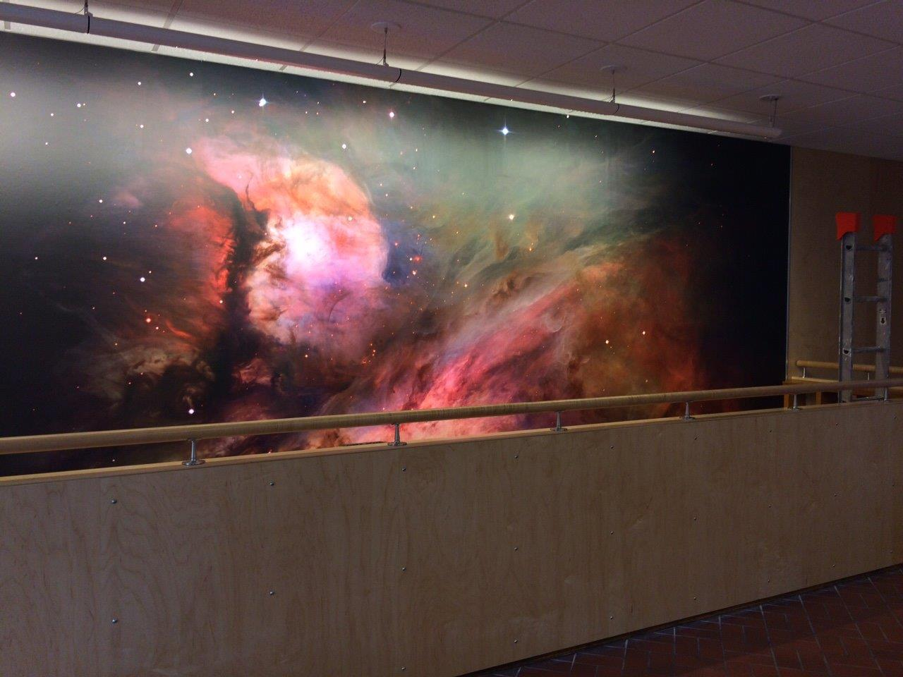The 18-foot image from the Hubble Space Telescope of the Orion Nebula is the siren attracting visitors downstairs to the Southworth Planetarium.